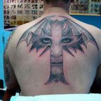 tattoos/ - Face in a cross - 49330